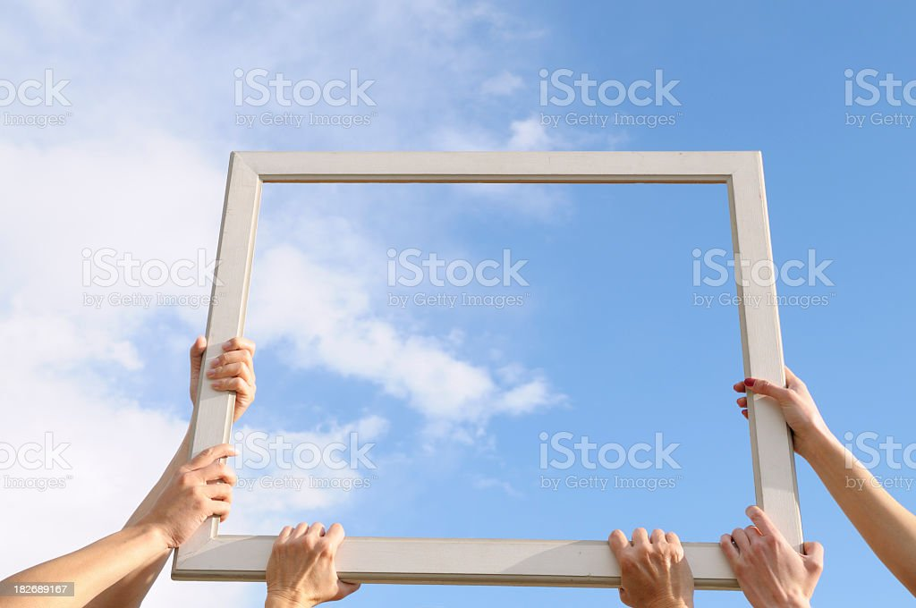 Six Hands Catching Clouds Blue Sky stock photo