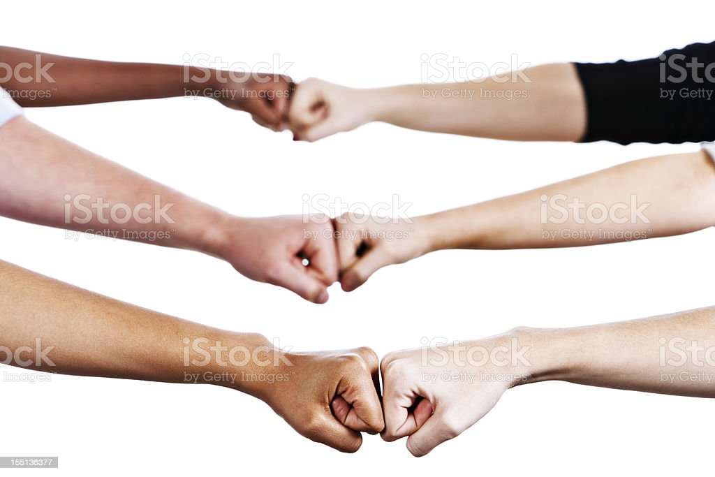 Six hands greet by bumping fists stock photo
