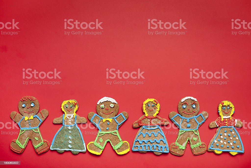 Six Happy Gingerbread Men and Women Christmas Cookies on Red stock photo
