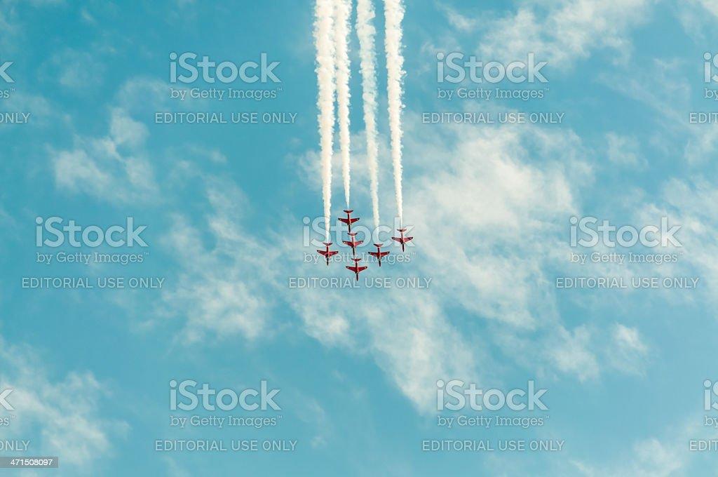 Six Hawk T1 jets form smoke stripe in blue sky royalty-free stock photo