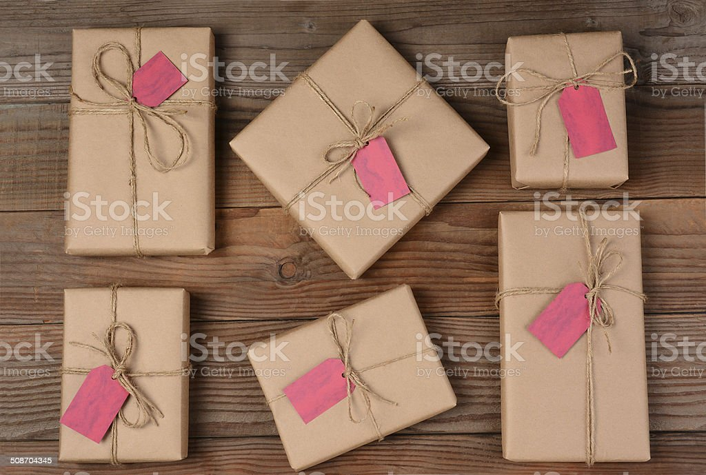 Six Holiday Packages on Wood Surface stock photo