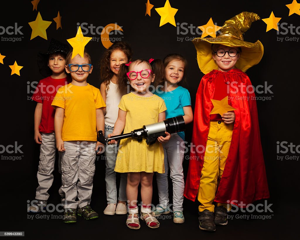 Six kids in stargazers costumes with telescope stock photo