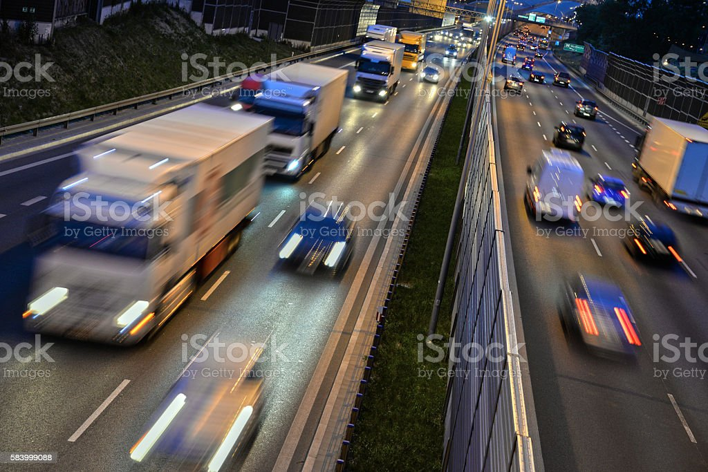 Six lane controlled-access highway in Poland by night stock photo