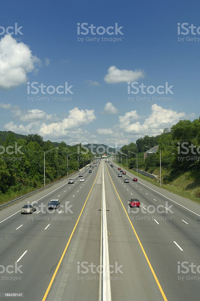 Six Lane Highway with Mid-day Traffic royalty-free stock photo