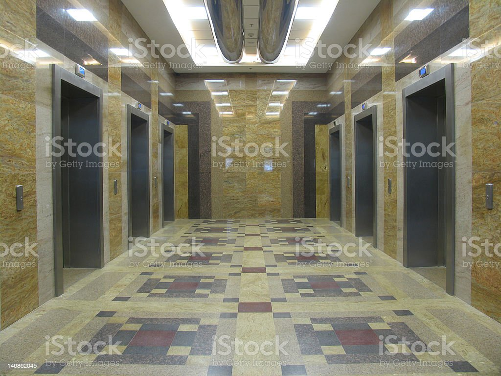 Six lifts in a modern office building stock photo