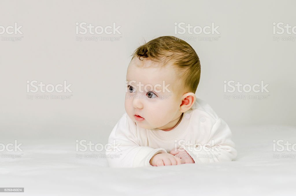 Six months baby isolated on white stock photo