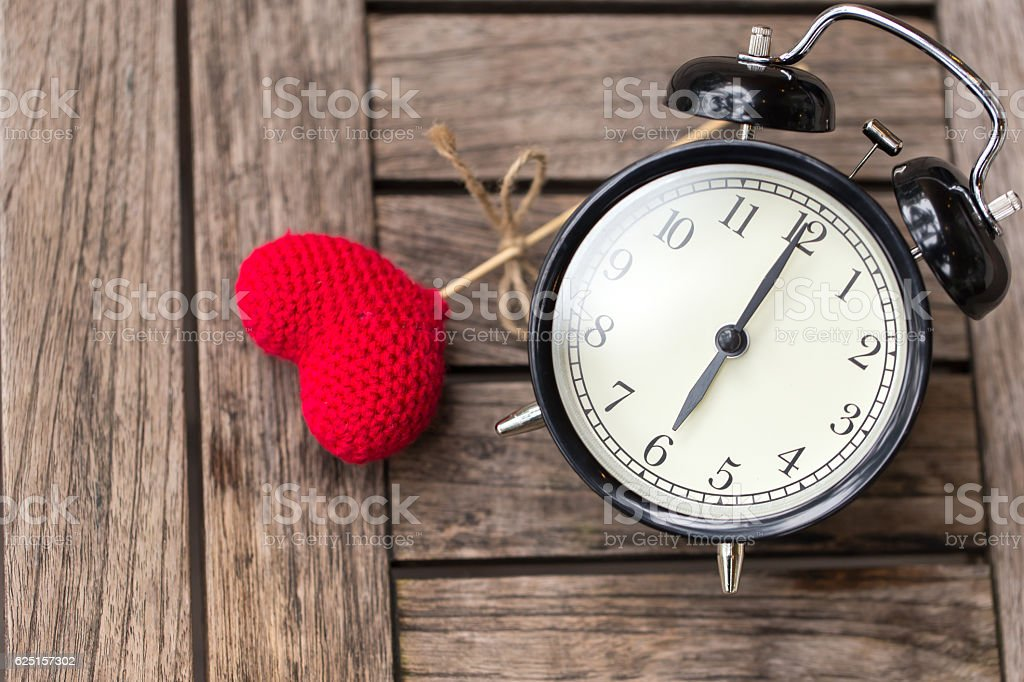 Six o'clock of retro vintage clock with red heart stock photo