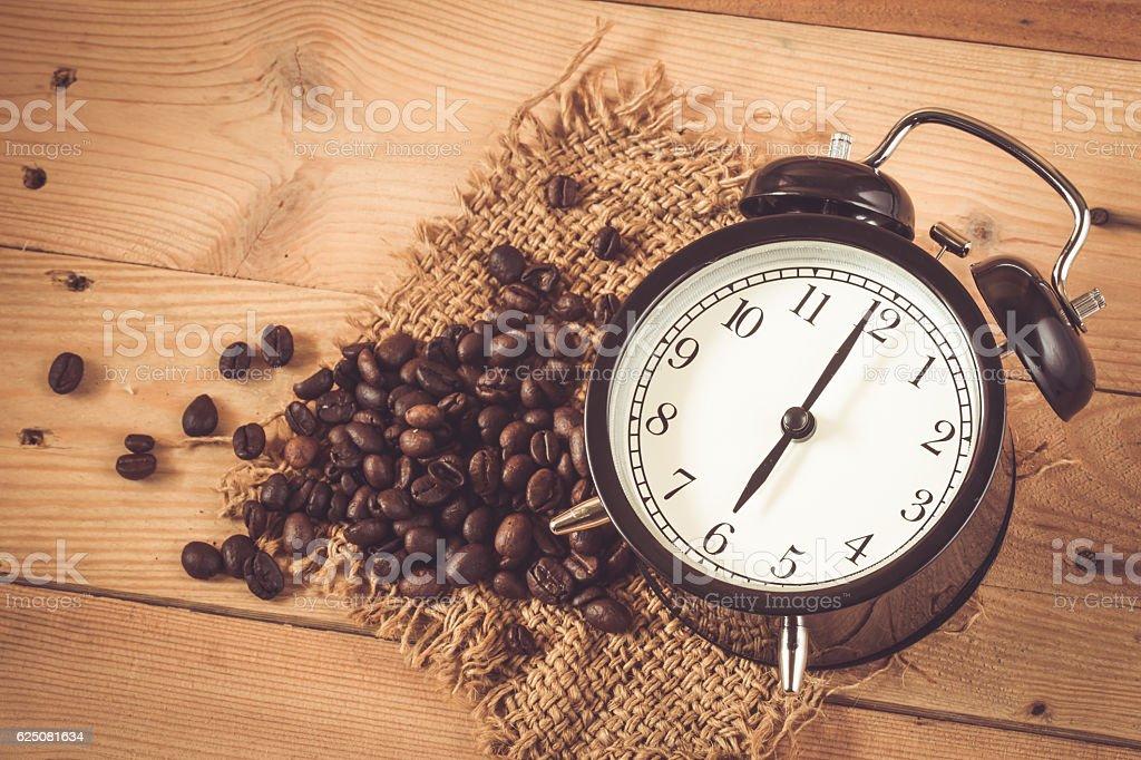 Six o'clock retro clock with Arabica coffee bean stock photo
