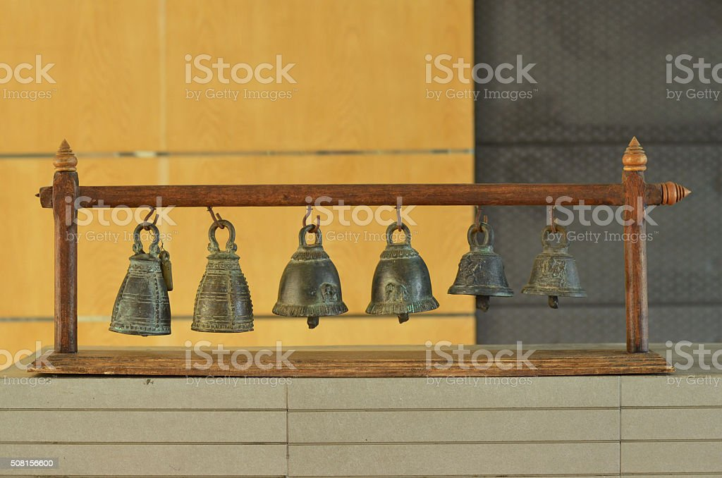 Six old bell on table/Home decoration bell stock photo