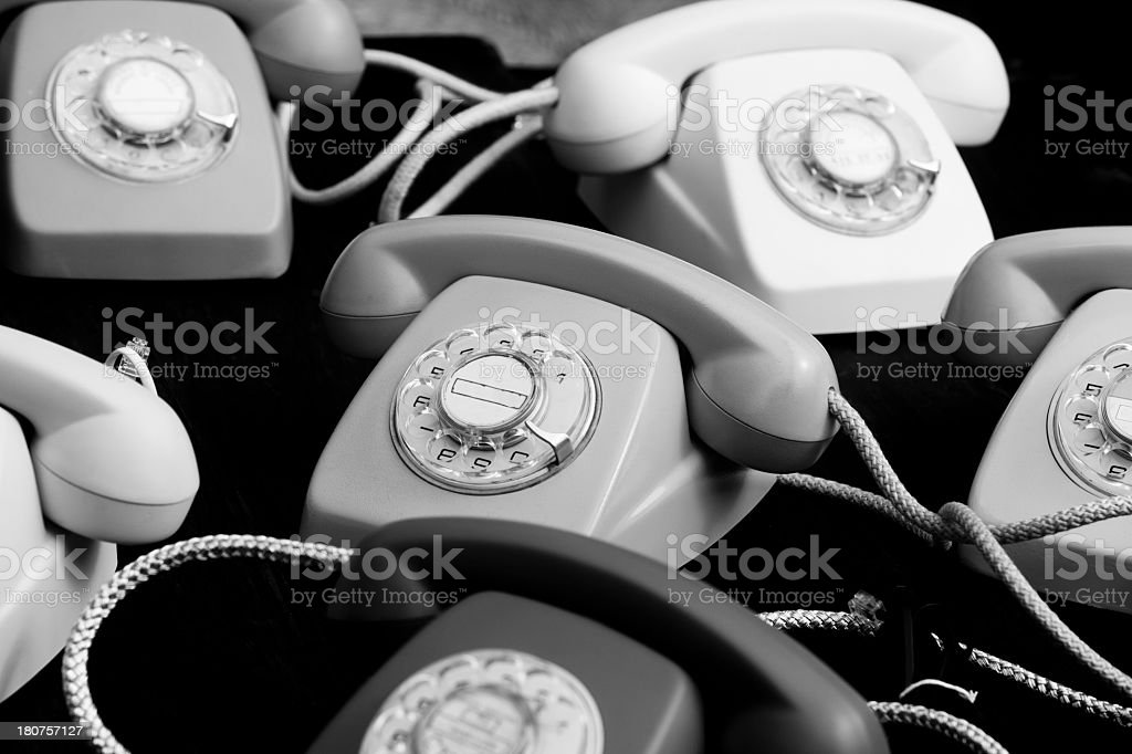 Six old styled ring telephones on a black background royalty-free stock photo