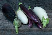 six organic grown eggplants