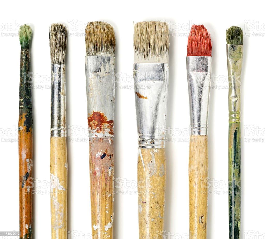 Six paintbrushes on white stock photo