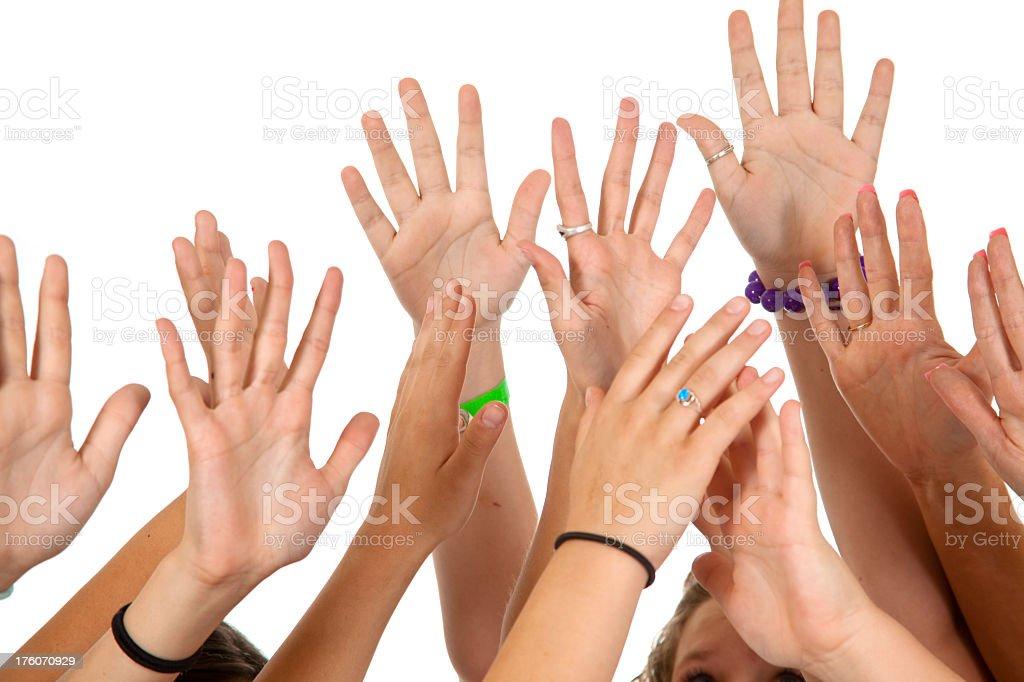 Six people's hands raised voting or volunteering. Multi-ethnic group. royalty-free stock photo