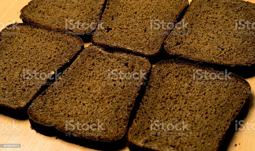 six pieces of black bread stock photo