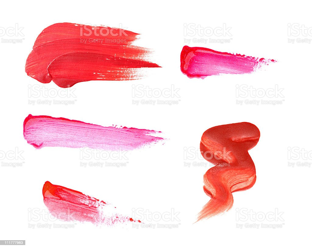 Six pink smudged lipstick stains on a white background royalty-free stock photo