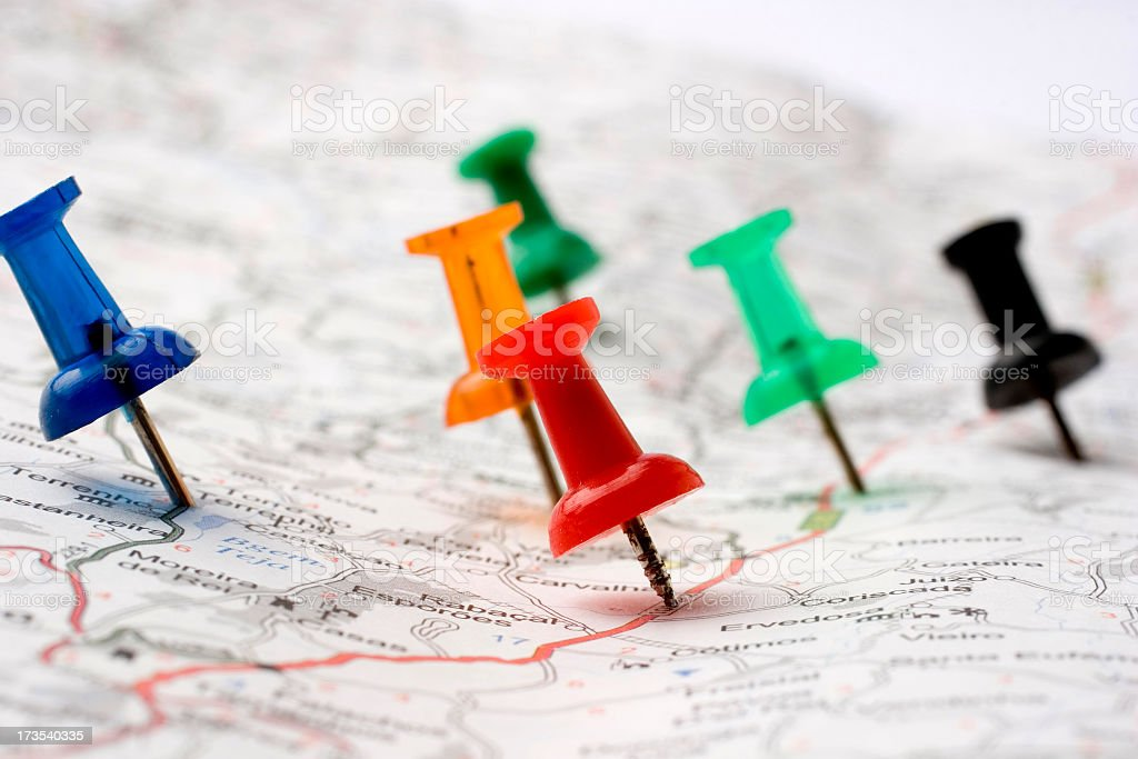 Six pins pointed on several spots on a road map stock photo