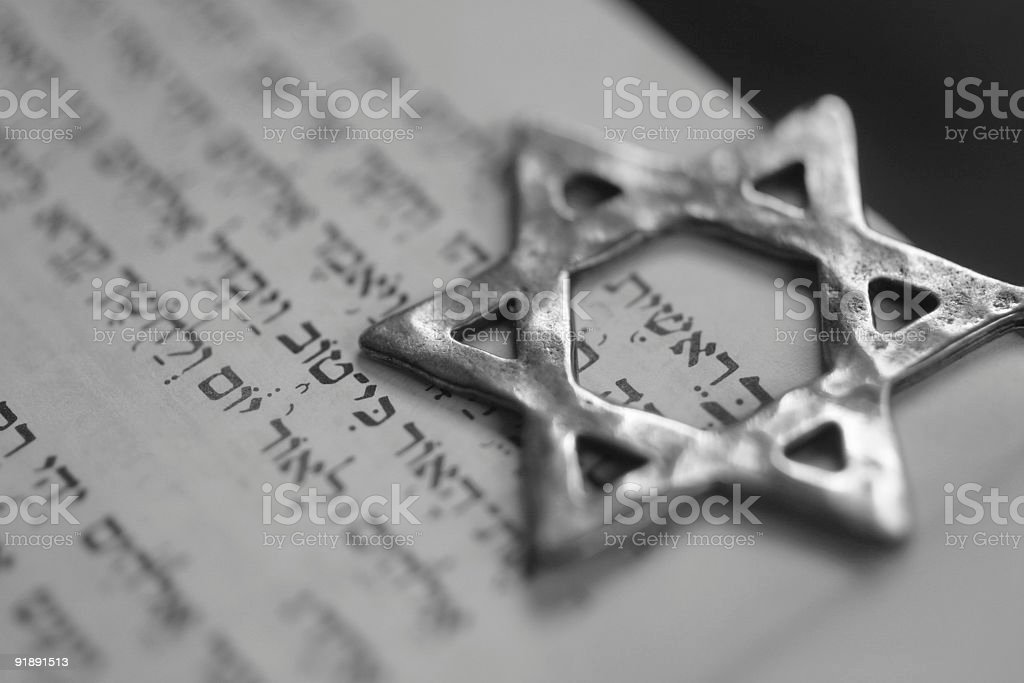 A six pointed metal star symbol on top of paper stock photo