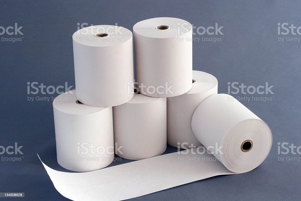 Six rolls of toilet paper over a gray background stock photo