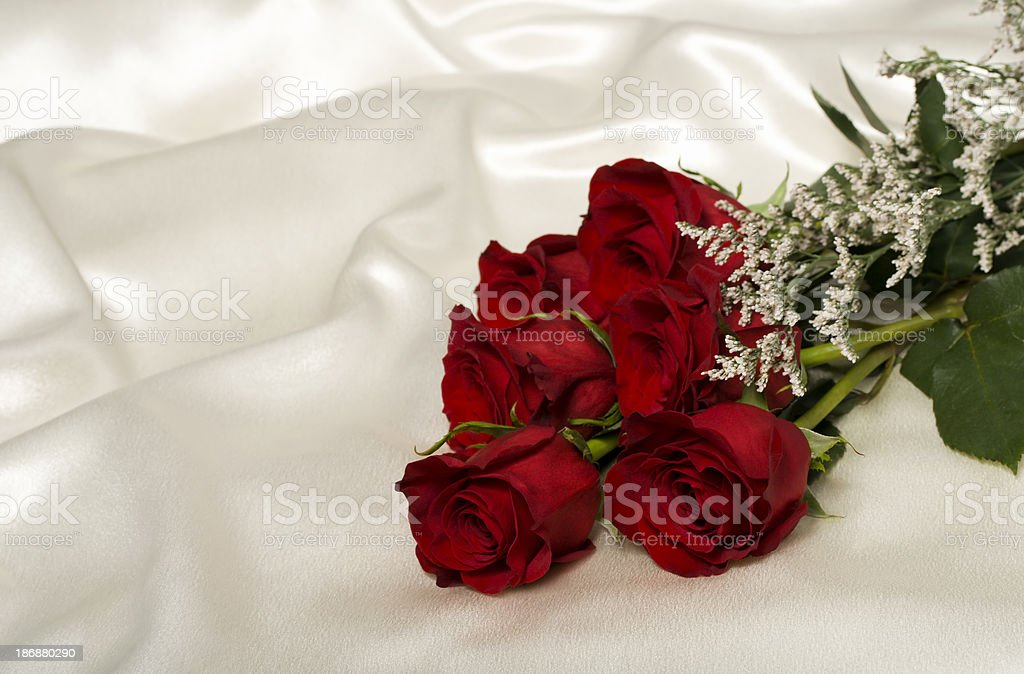 Six roses on satin royalty-free stock photo