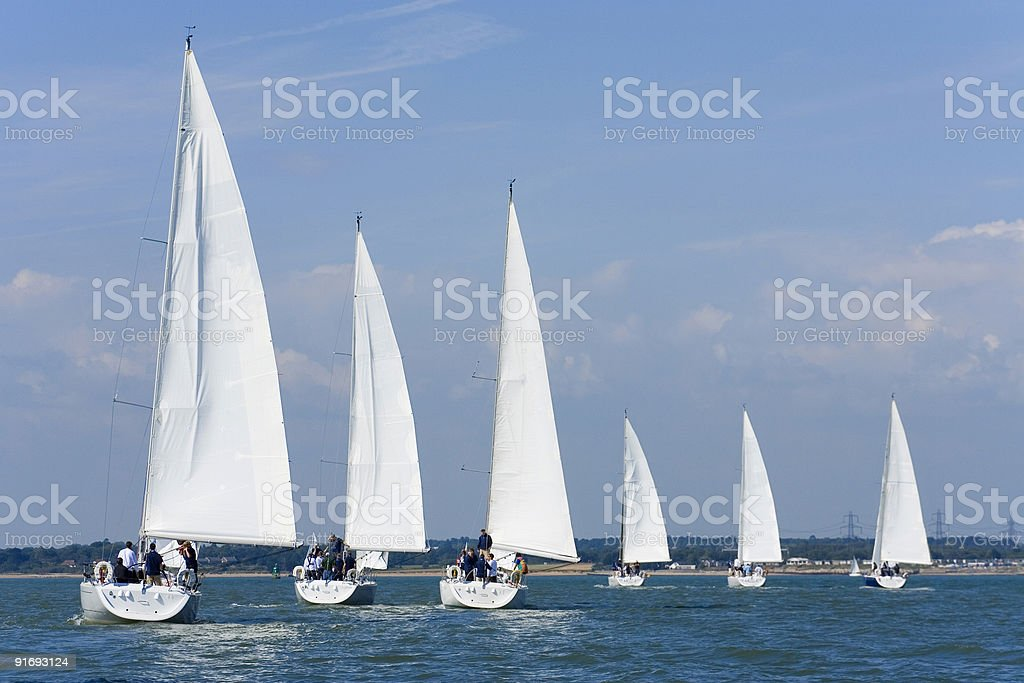 Six Sailing Ship Yachts With White Sails In A Row stock photo