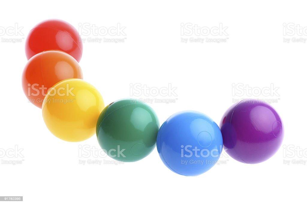 Six shiny coloured plastic toy balls isolated on white royalty-free stock photo