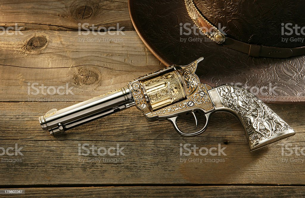 Fancy six shooter and cowboy hat.
