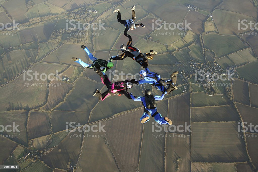 Six Skydivers performing a formation royalty-free stock photo