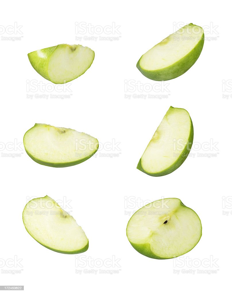Six sliced pieces of green apple royalty-free stock photo