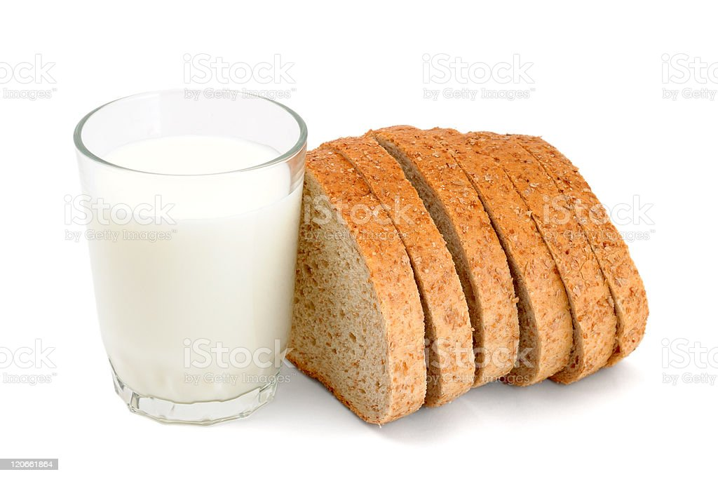 Six slices of bread and a full glass of milk stock photo