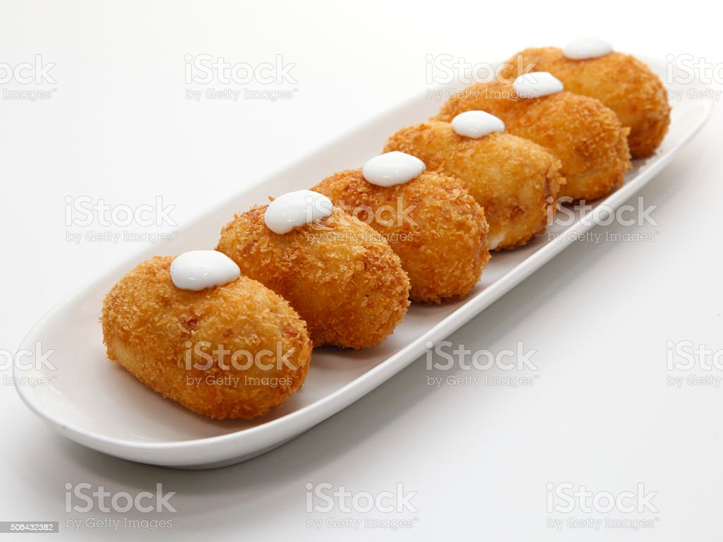 Six spanish croquettes with mayonnaise. Typical Tapa of Spanish Cuisine stock photo