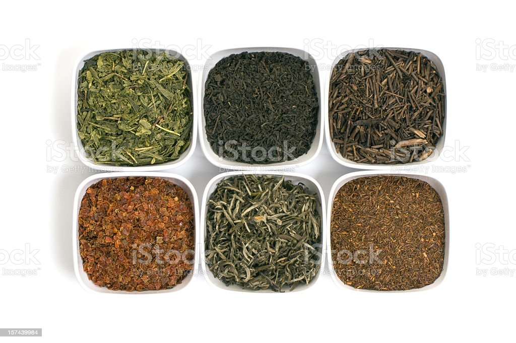 Six square bowls with assorted tea leaves royalty-free stock photo