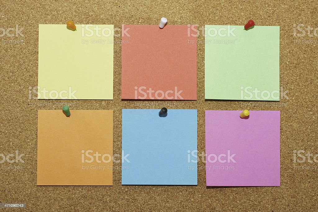 Six blank Post-It notes pinned to noticeboard various colours notelets royalty-free stock photo
