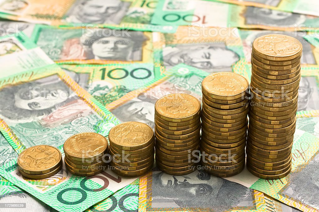 Six stacks of gold coins shows growing funds stock photo