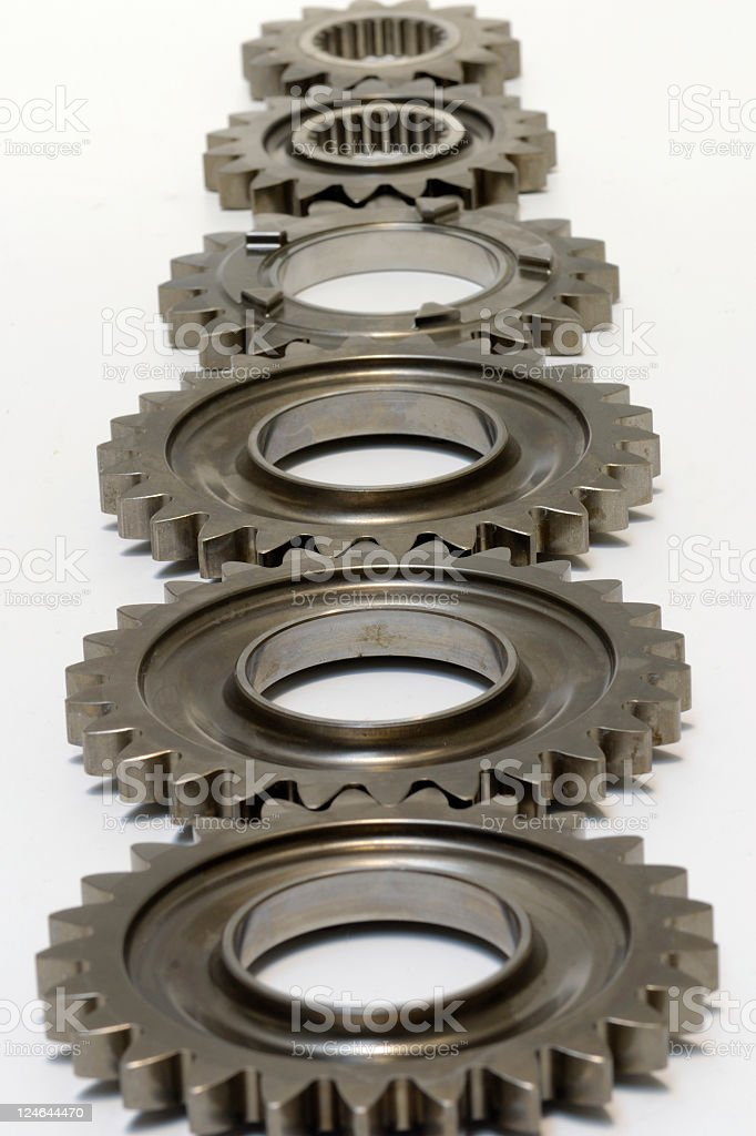 Six steel gears in a row isolated royalty-free stock photo