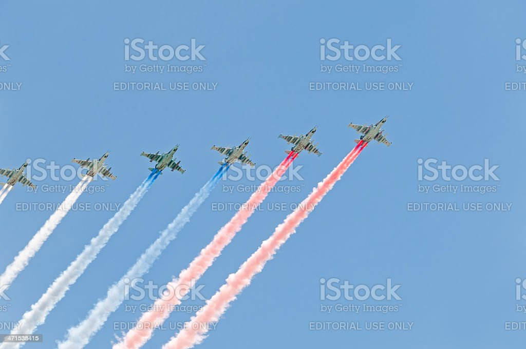 Six Su-25 form in sky tricolor flag by color smokes royalty-free stock photo