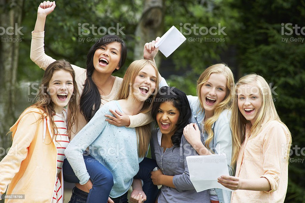 Six Teenage Girls Celebrating Successful Exam Results stock photo