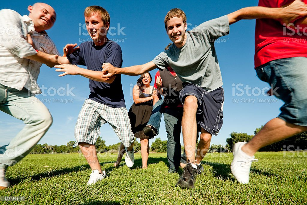 Six Teenagers Running in a Field stock photo