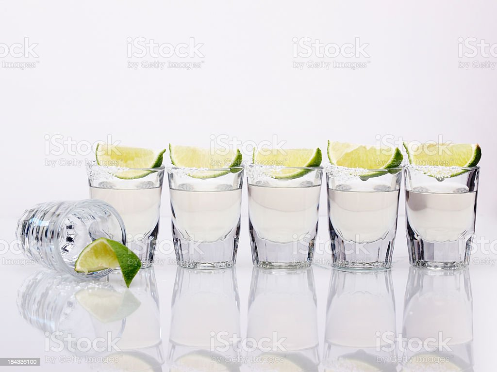 Six tequila shots on a white background stock photo