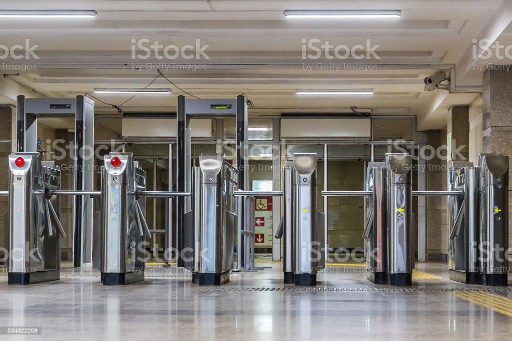 Six turnstiles stock photo