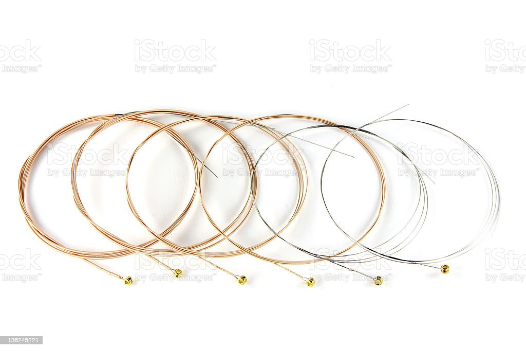 Six ultra thin Acoustic Guitar Strings on white background royalty-free stock photo