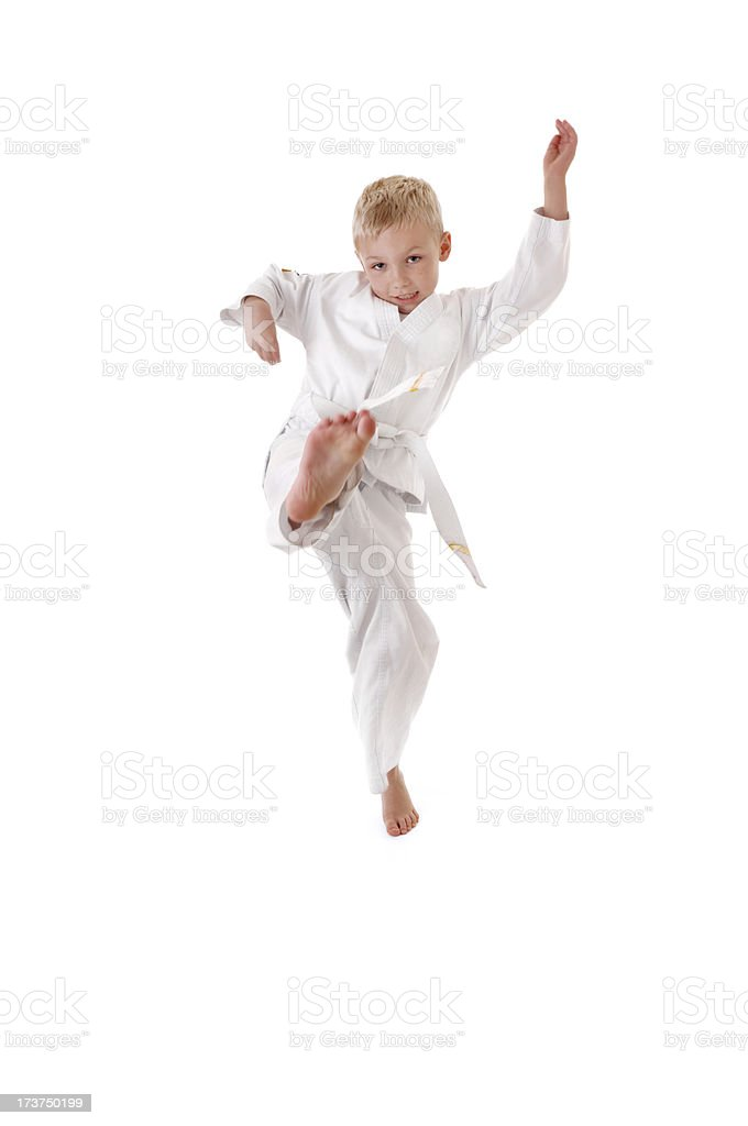 six year old boy practicing his martial arts royalty-free stock photo