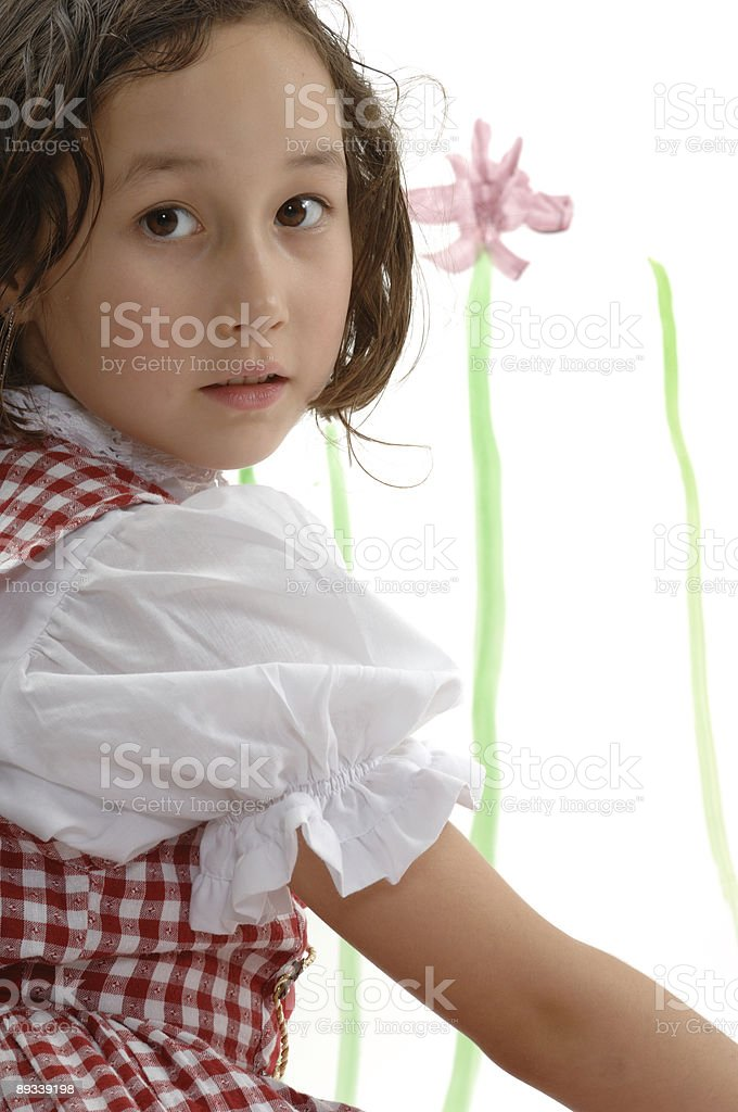 Six year old girl - painting water flowers royalty-free stock photo