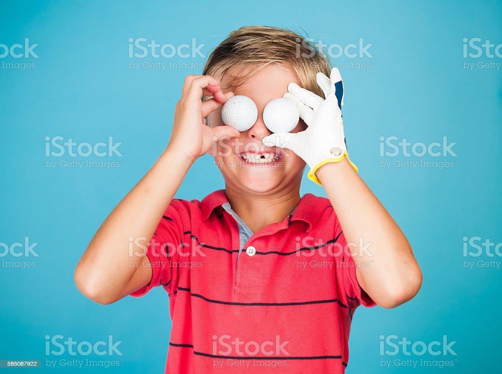 Six Year Old Junior Golfer Goofing Around stock photo