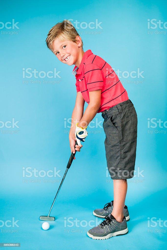 Six Year Old Junior Golfer Putting stock photo