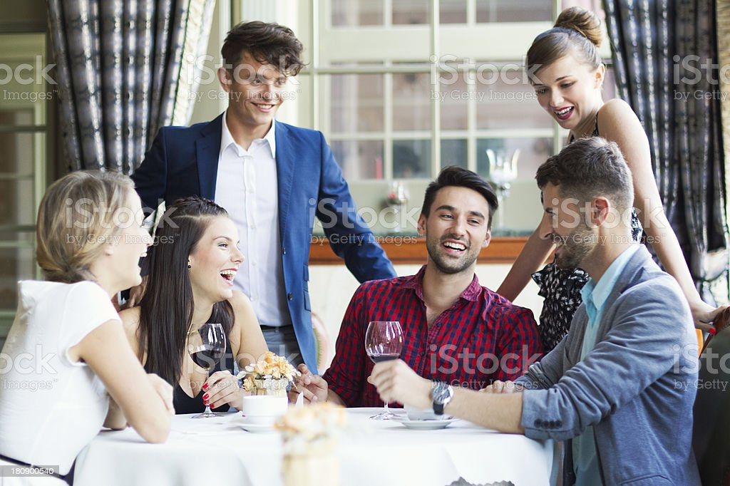 Six young people, smiling, at a social gathering royalty-free stock photo
