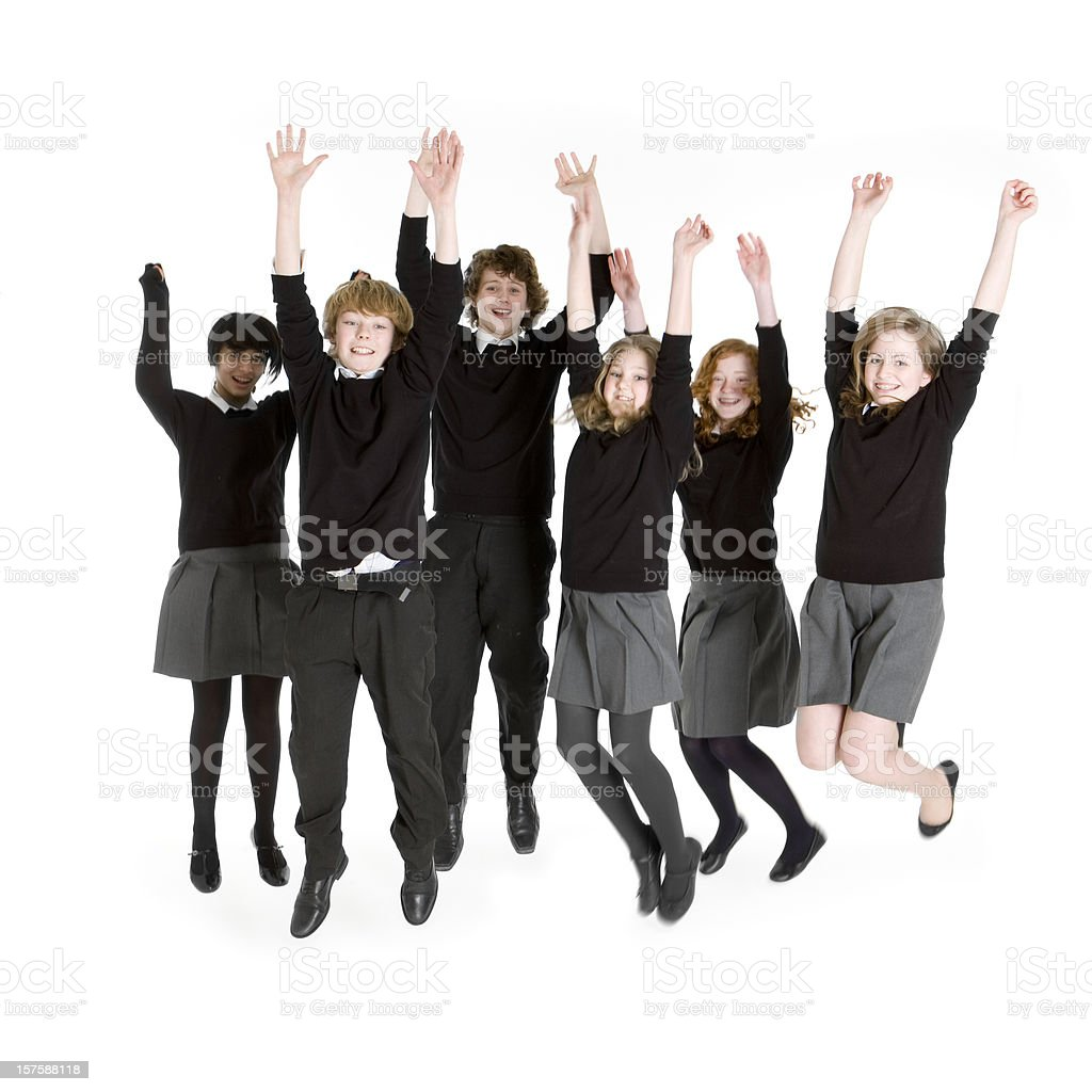 Six young teenage students jumping for joy royalty-free stock photo