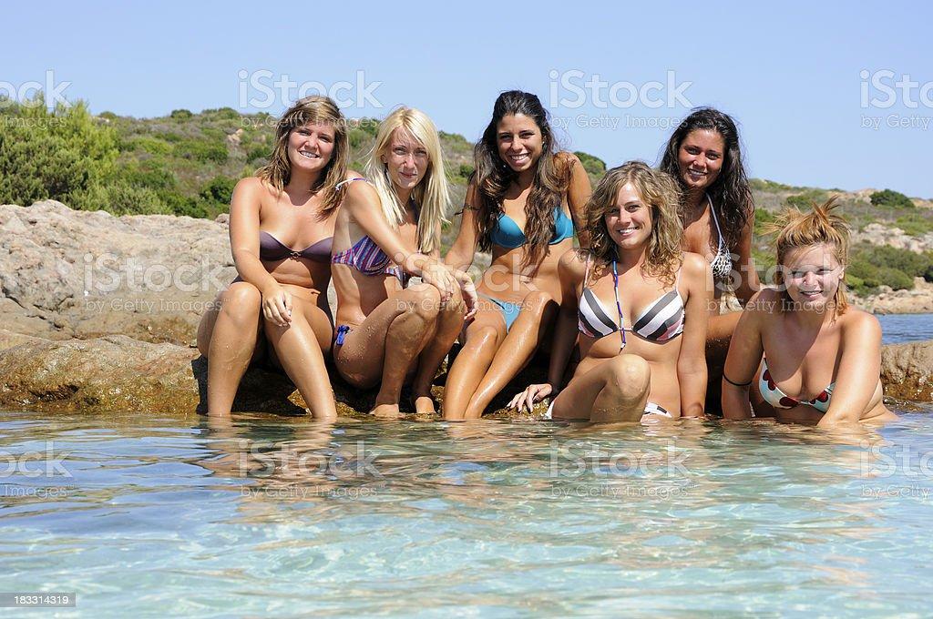 Six Young Women in Bikini on the Rocks royalty-free stock photo