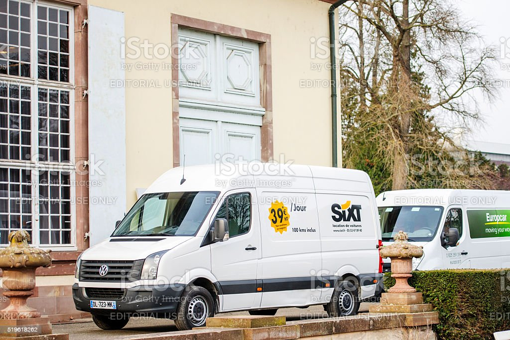 Sixt and Europcar renting vans in front of building stock photo