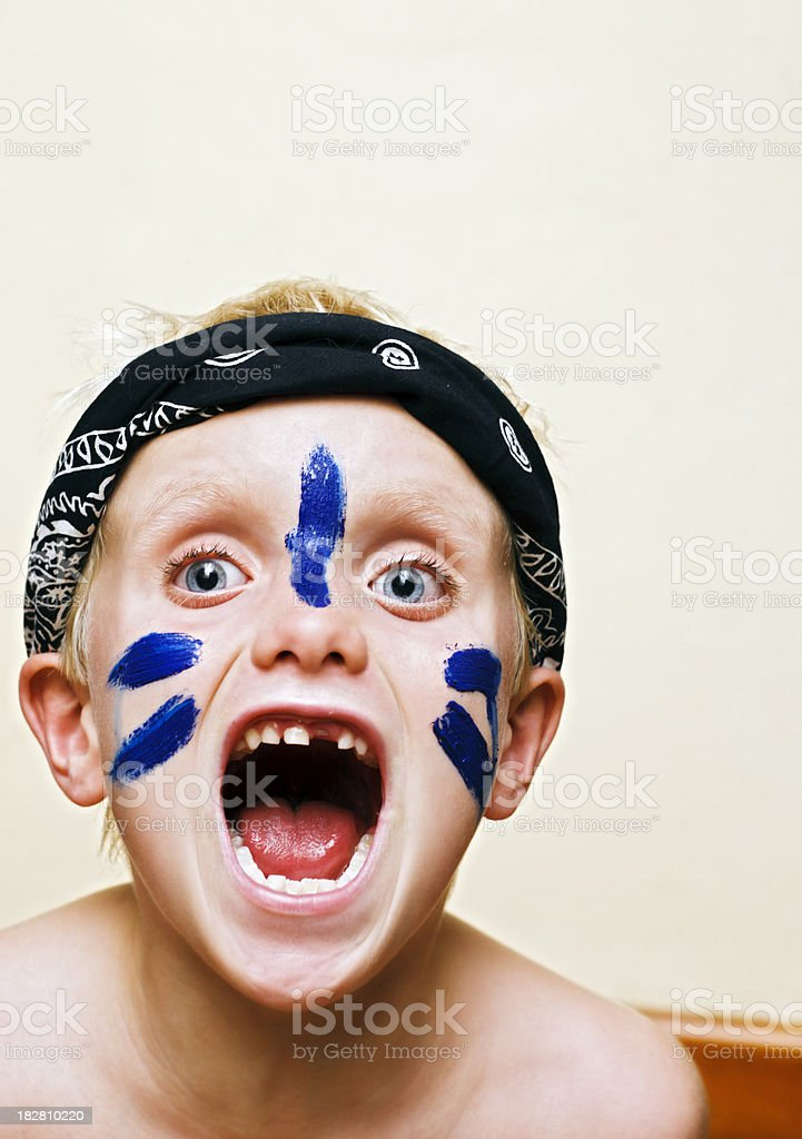 Six-year-old boy dresses up as fierce warrior stock photo