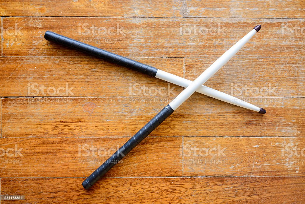 Size 5A hickory drumsticks painted white stock photo